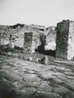 10103-5-warscher-codex-69-640.jpg I.1.3-5 Pompeii. 1936, taken by Tatiana Warscher. Looking towards entrance doorways on Via Stabiana. I.1.5 is on the left with the remains of its bench. See Warscher T., 1936. Codex Topographicus Pompeianus: Regio I.1, I.5. (no.12), Rome: DAIR, whose copyright it remains.