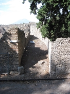 Pompeii. Street altar near I.1.10, on corner of unnamed vicolo between I.1 and I.5, looking north. Photo taken from unnamed vicolo between these insulae and the city walls. Photo courtesy of Drew Baker.