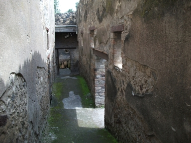 I.10.14 Pompeii. May 2010. Looking east along corridor from peristyle of I.10.4, leading to service quarters.
