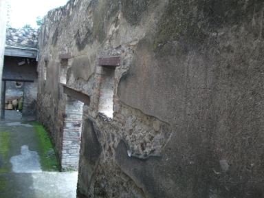 I.10.14. I.10.4 Pompeii. May 2010. South wall of passage P.