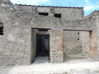 I.10.17 Pompeii, on right. May 2017. Looking west to shop entrance, with doorway to I.10.16, on left.  Photo courtesy of Buzz Ferebee.