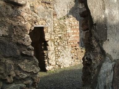 I.10.8 Pompeii.  December 2004.  Doorway to room 3 on east side of atrium.