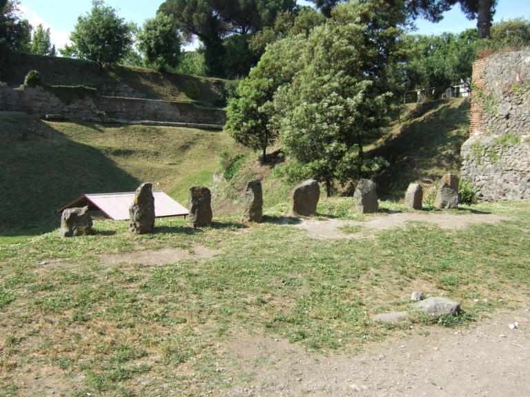Pompeii Porta Nocera. Tomb 34EN, tomb of Afrea Prima?  May 2006. The tomb has eight cippi. The seventh one from the west has a triangular top and an inscription AFREIA M(arci)  L(iberta)  PRIMA. This does not necessarily name the tomb. See D''Ambrosio, A. and De Caro, S., 1983. Un Impegno per Pompei: Fotopiano e documentazione della Necropoli di Porta Nocera. Milano: Touring Club Italiano. (34EN).