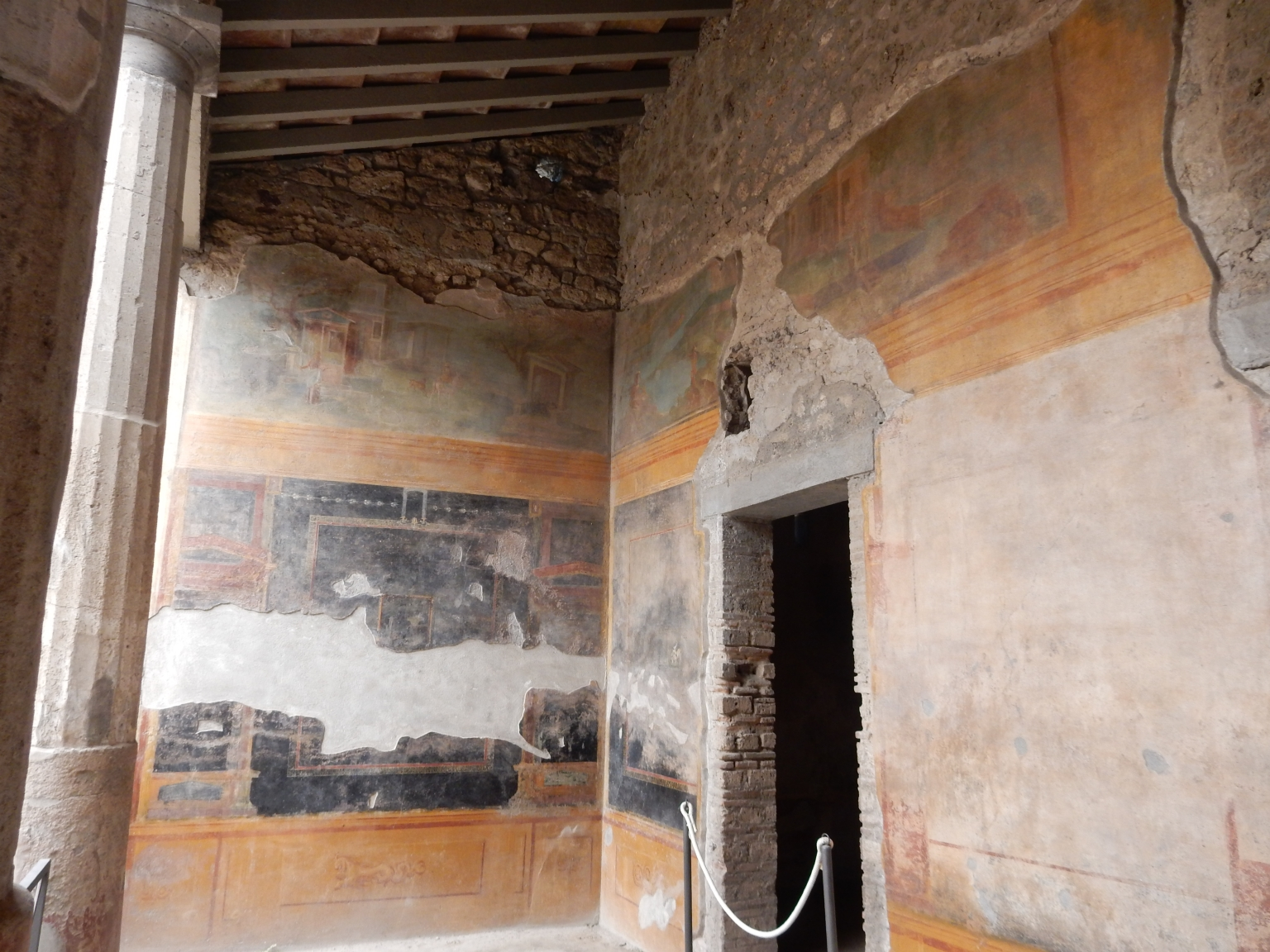 VI.8.23 Pompeii. May 2017. Looking towards the north-west corner of north portico with doorway to room, on right. Photo courtesy of Buzz Ferebee.