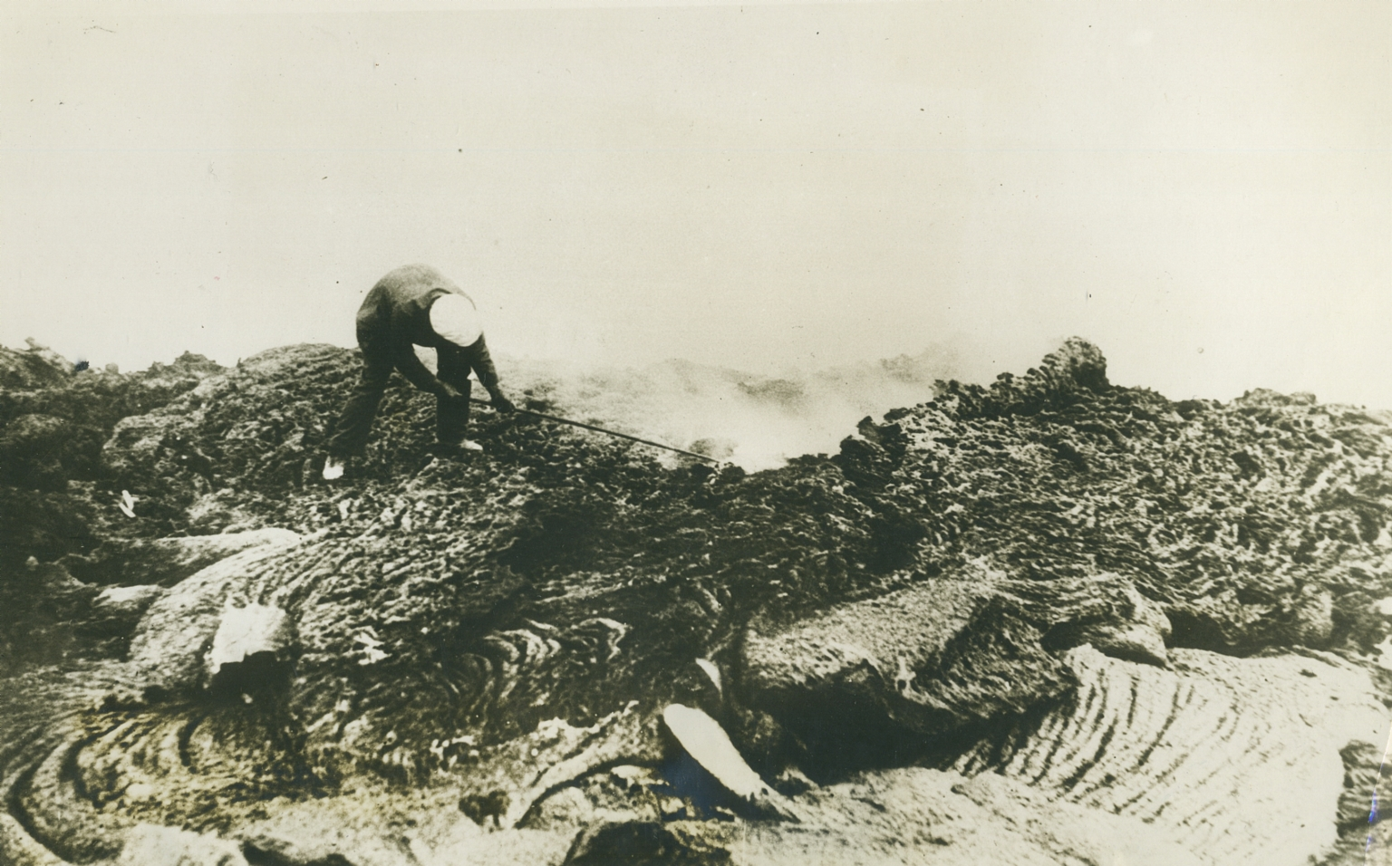 Vesuvius. 1st August 1930 press photo. New crater formed on Vesuvius. Photo courtesy of Rick Bauer. On the rear of the photo it says: 'New crater formed on Vesuvius. An observer from the Mt. Vesuvius observatory examining the lava of the new crater recently formed by violent eruptions of Mount Vesuvius which were followed by earthquakes which took a toll of more than 15,000 lives'